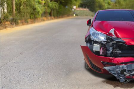 Front of light red color car have big damaged and broken by accident on road in morning time can not drive any more park for wait insurance officer. With copy space for text or design