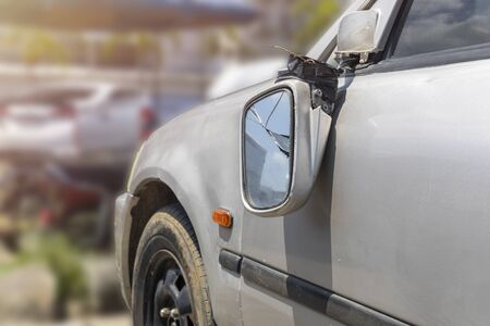 Car accident broken car door rearview mirror.