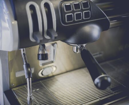 Close-Up of coffee machine in the coffee shop. len blur effect Soft focus and focus to Steam Milk stick. Process with vintage style