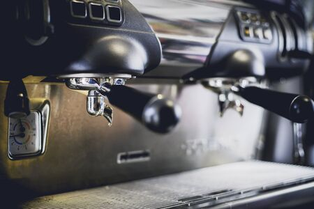 Close-Up of coffee machine in the coffee shop. len blur effect. Process with vintage style 版權商用圖片