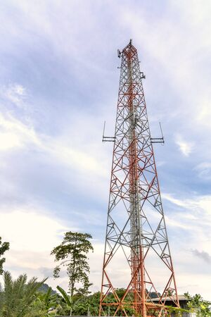 mobile phone communication and network signal repeater antenna tower with blue sky background Imagens