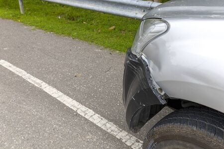 Front of light gray color car with pick up have big damaged and broken by accident on road can not drive any more park for wait insurance officer. With copy space for text or design
