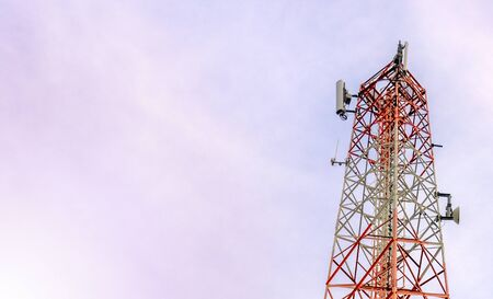 mobile phone communication and network signal repeater antenna tower with blue sky background. With copy space for text or design Imagens