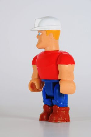 Standing construction worker with turned head in the hardhat