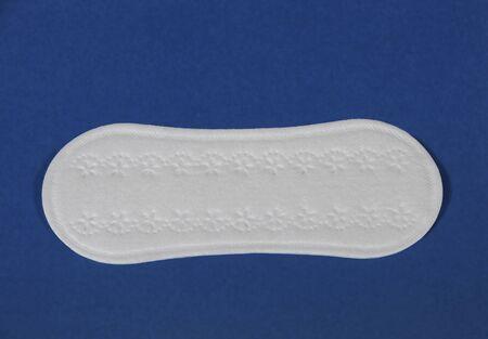 necessity: Sanitary Napkin on deep blue background