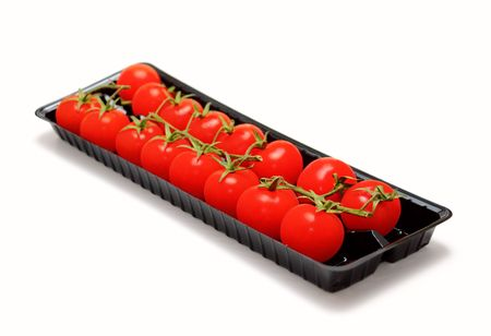Cherry tomatoes packed in a box photo