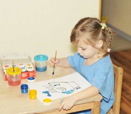 children painting: Toddler girl paints by gouache