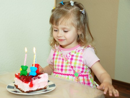 Happy girl on birthday with cake Stok Fotoğraf