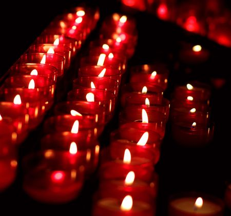 Burning candles in catholic church photo
