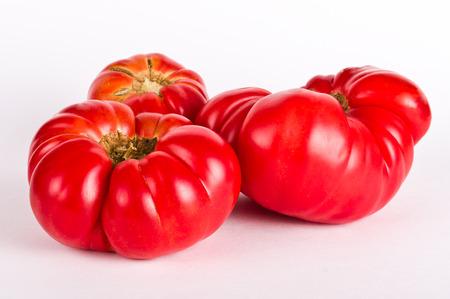 Ugly tomatos on white background
