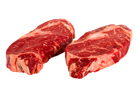 Ribeye steaks isolated on white background Stock Photo