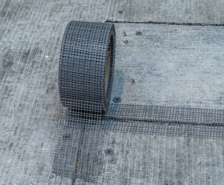 sealing tape: Fragment of cement board floor with sealing tape