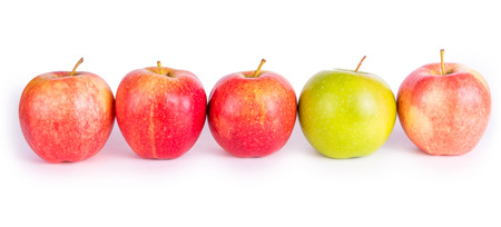 Red apples with the one green Stock Photo