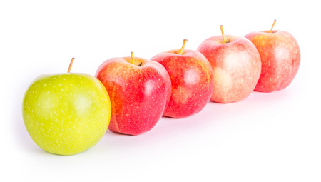 order chaos: Red apples with the one green Stock Photo