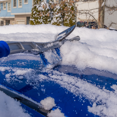 Removal snow from car body with brush
