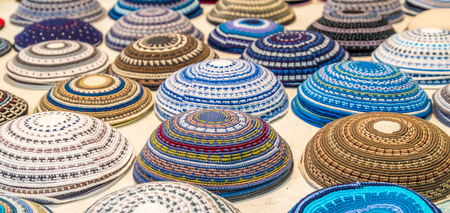 kippah: big variety of kippah at juwish market Stock Photo