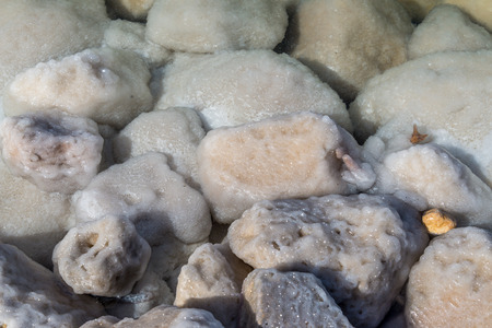sediments: Rocks covered with salt at Dead Sea Stock Photo