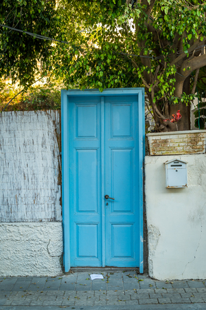 fense: Old blue wood door entrance to garden Stock Photo
