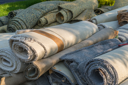 redecorating: old carpet rolls removed from hpme and ready to be throw out