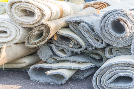 old carpet rolls removed from hpme and ready to be throw out Reklamní fotografie - 41603511