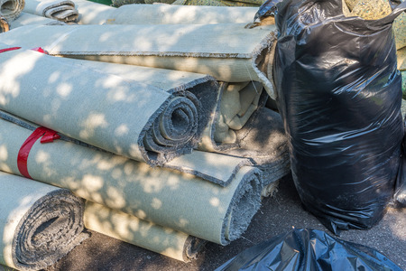 old carpet rolls removed from hpme and ready to be throw out