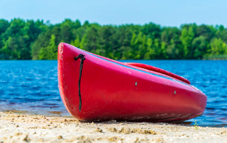 lake beach: Kayak laying on a lake beach