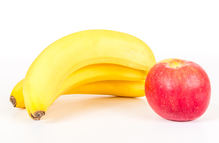 Three bananas and apple isolated on white background Stock Photo