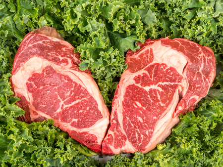 rib eye: Dry aged rib eye steaks on the salad leafs