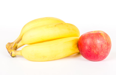 flesh colour: Three bananas and apple isolated on white background Stock Photo