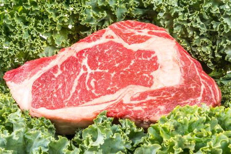 rib eye: Dry aged rib eye steaks on the salad leafs