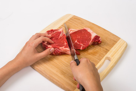 Cut ribeye steak on wooden board