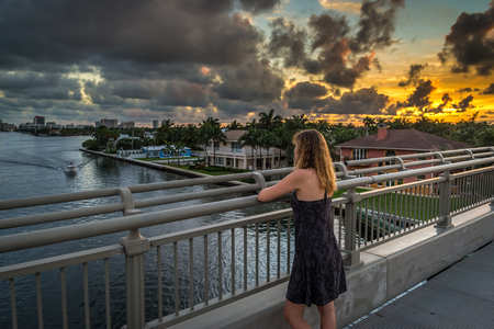 Woman looking at river from the bridge