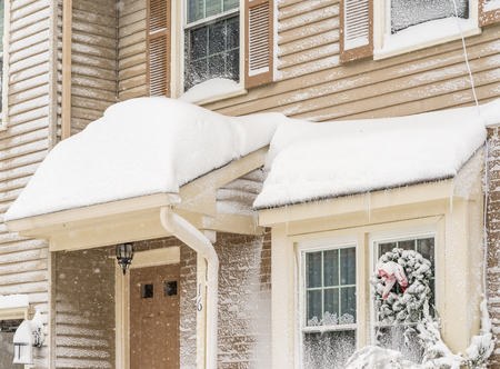 heavy snow: Snow drifts on roof during the heavy snow storm