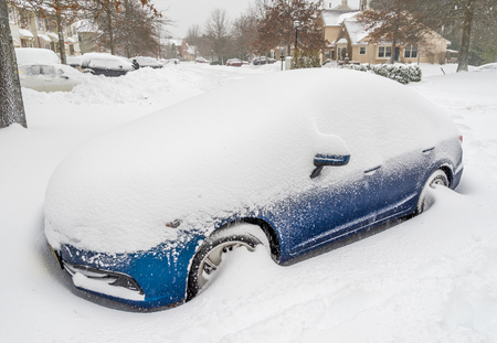 snow storm: Car covered with snow after heavy snow storm