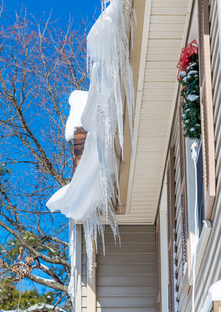 Icicles on roof after two days of snowfalls