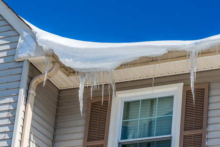 snowfalls: Icicles on roof after two days of snowfalls