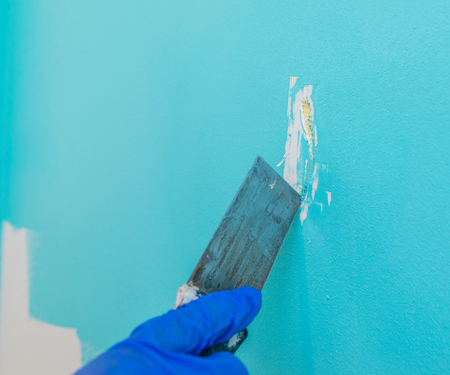 scraping: Remove paint from the wall with metal putty