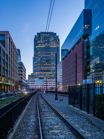 Tram line in Jersey City with city skyline on background
