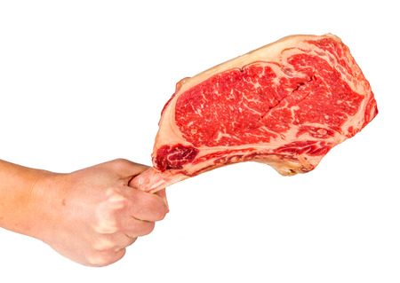 Prime rib steak isolated on white background