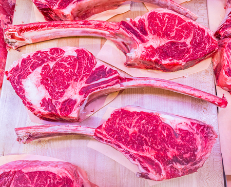 Stock photo of beef steaks at the butcher store
