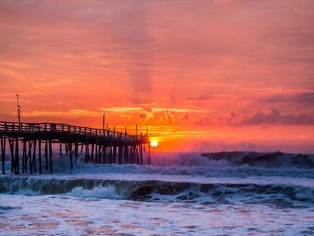 Serene sunrise over fishing pier at North Carolina Outer Banks