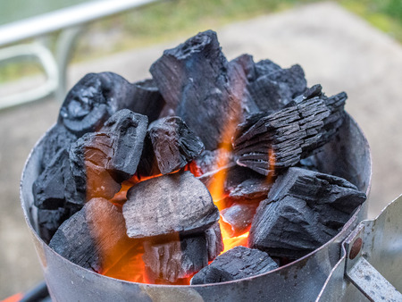Starting charcoal for grill cook