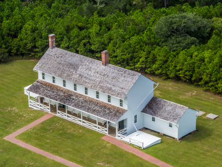 hatteras: Historic american houses next to Hatteras Lighthouse Stock Photo