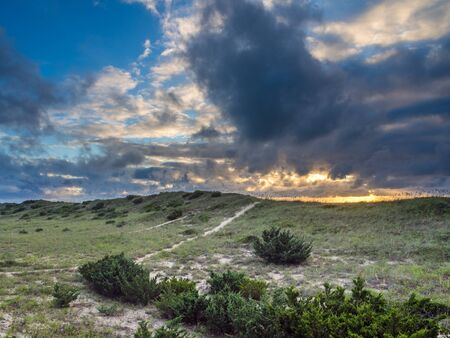 hatteras: Cloudy sunrise over the dunes at Hatteras Island, NC