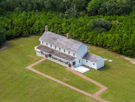 Historic american houses next to Hatteras Lighthouse Stock Photo