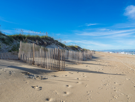 Wood fence at the sandy beach of Hatteras Island, NC