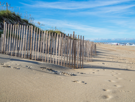 hatteras: Wood fence at the sandy beach of Hatteras Island, NC