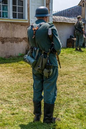 Man in German World War II soldier uniform seen from his back