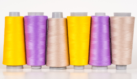 Group of vary colored thread coils