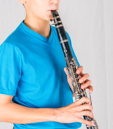 Stock close-up photo of clarinet in the hands of boy